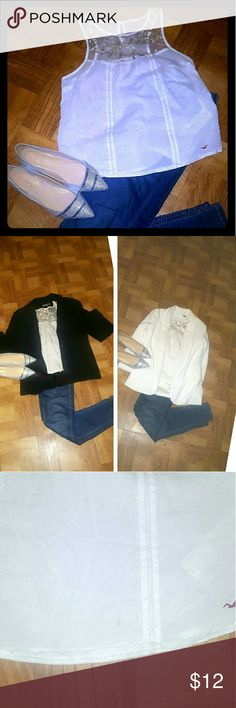 🎉NEW LISTING🎉 sleevless semi sheer hollister top Silver & white sleevless hollister top. Has silver embellishments over the front with a button keyhole back. Perfect to go under any blazer or cardigan or just to wear alone. Does have a minor mark shown on 3rd pic can probably come out with clorox. Priced to sell Hollister Tops