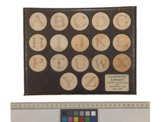 Ivory discs engraved with letters of the alphabet. 1760. In the John Johnson collection of ephemera in the Bodleian library.