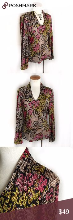 """Etcetera Pixelated V-neck Blouse Thin, silky v-neck blouse with pixelated burnout floral print in pink, yellow, red, and brown on black. Elastic cuffs and soft draping at neckline. Somewhat sheer so a cami can be worn underneath. 92% polyester; 8% spandex. Size Small. Bust: 17.5"""" flat across. Length: 22.5"""". Sleeve length: 23.5"""". EUC. Thanks for looking! Etcetera Tops Blouses"""