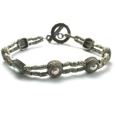 Tabatha Bracelet - 7 inches - Toggle clasp - FREE domestic shipping $29.99 Order here online The Tabatha Bracelet is delicate and powerful. Tibetian Silver peppered with AB crystals create a huge v...