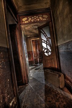 Even through all the accumulated neglect, the details haunt me.  Inlaid floor, carved wood, textured walls, light patterns from many angles