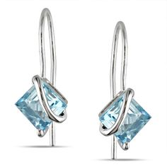 Adorn your ears with dazzling beauty when you slip on these blue topaz earrings…