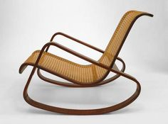 Italian 1940's mahogany rocking chair with cane seat and back (attributed to  GIUSEPPE PAGANO)
