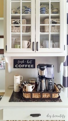 An outdated oak cabinet gets a fresh, farmhouse update with paint! See the progr… An outdated oak cabinet gets a fresh, farmhouse update with paint! See the progress at diy beautify! Coffee Station Kitchen, Coffee Bars In Kitchen, Coffee Bar Home, Home Coffee Stations, Coffe Bar, Farmhouse Cabinets, Diy Cabinets, Kitchen Cabinets, Coffee Nook
