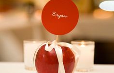 Apple and a satin bow makes the perfect name place setting.