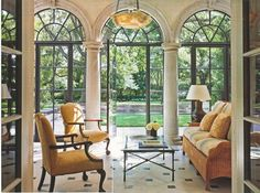 tiled indoor-outdoor living room with arched French doors (AD)