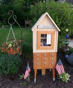 This is the Little Free Library my son and husband made me for my birthday. I'm a school library media specialist so the repurposed card catalog is perfect!  Open for business Spring 2014.