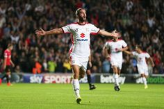 Grigg scored twice as MK Dons pulled off a stunning 4-0 win