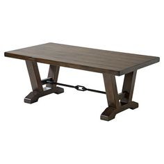 A perfect addition to your living room or den, this lovely wood and metal coffee table showcases a trestle-style base and walnut finish.