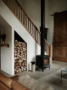 wood burning stove in front of the stairs in the beautiful, nature inspired home of ceramicist Kelli Cain. Photo: Pia Ulin.