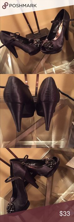 Black satin platforms Black platform satin heels with black stones/ankle strap. Very comfortable and has some wear that's noticeable on the sole. Other than that the shoe itself has no damage Steve Madden Shoes Platforms