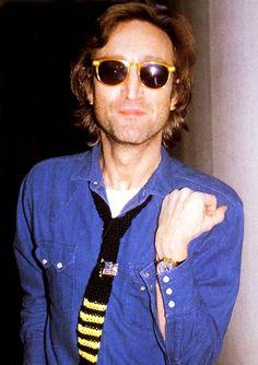 John Lennon flashing his 18k yellow gold Patek Philippe moonphase wrist watch