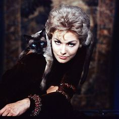 "This image of Kim Novak with a siamese cat appeared on the cover of LIFE magazine in November 1958. She was promoting the film ""Bed, Book and Candle."" (Ralph Crane—The LIFE Picture Collection/Getty..."