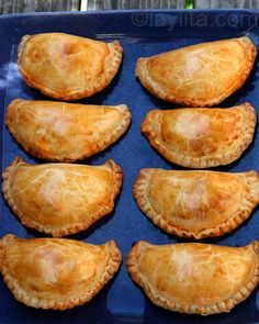 Easy recipe for empanadas mendocinas, traditional Argentinean baked empanadas filled with beef, onions, paprika, hot pepper powder, cumin, oregano, hard-boiled egg and olives.
