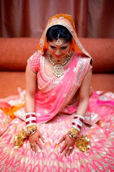 Bride in an Anita Dongre lehenga. Indian bride wearing bridal lehenga and jewelry. #IndianBridalHairstyle #IndianBridalMakeup #IndianBridalFashion