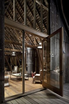 Canyon Barn is a renovation project completed by Seattle-based MW Works Architecture. Old barn renovated and converted into a retreat. Architecture Renovation, Barn Renovation, Architecture Design, Architecture Office, Barn Living, Living Room, Interior Barn Doors, Garage Interior, Interior Walls