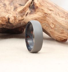 Titanium Lined with Bluewood (Blue Stabilized Redwood) Burl Wooden Ring Titanium Ring. $195.00, via Etsy.