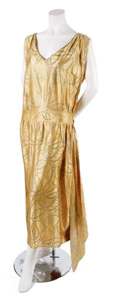 A Gold Brocade Dress, 1921, in a straight fit. Labeled: Thurn/Paris New York.