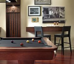 Man Cave Must Haves #mancave 2 chair and table hanging on wall!!! love to save room