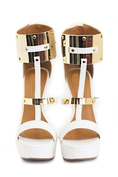 Perfection. Gold plates on shoes/ belts are so in right now http://www.hauteandrebellious.com