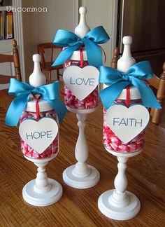 Apothecary Jars.  I will use red or pink ribbon but I LOVE the idea of the hearts with faith, hope, love