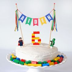Cake Gallery: Super-Simple Lego Birthday Cake Legos have got to be one of the most timeless and durable toys in the world! We LOVE Legos in my house! There are some really amazing cake ideas out there for a Lego Birthday Party….if you're willing to sculpt 6th Birthday Cakes, Lego Birthday Party, Birthday Cake Toppers, Lego Cake Topper, Lego Birthday Banner, Easy Kids Birthday Cakes, Lego Batman Birthday, Birthday Ideas, Women Birthday