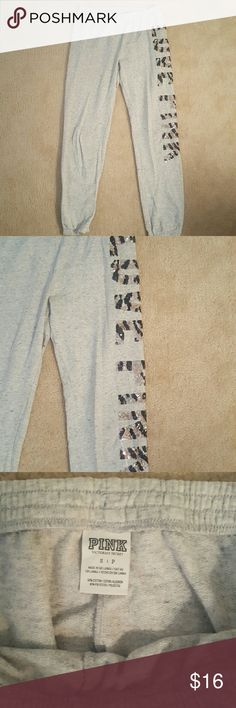 "Women's Victoria's Secret PINK Sweatpants Women's Victoria's Secret PINK Sweatpants. Women's Size small. Light gray with a Sequin Leopard Print logo ""Love Pink"" on one side of leg. Used but still in good condition. PINK Victoria's Secret Pants Ankle & Cropped"