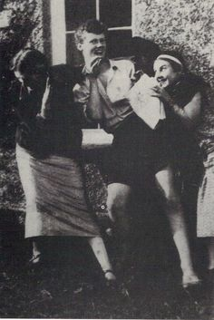 Virginia Woolf (left) laughing with her nephew, Quentin Bell, and Lydia Lopokovna