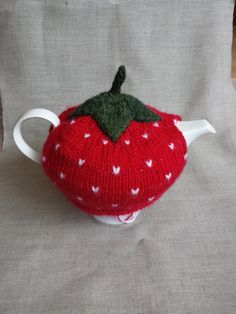 Check out this item in my Etsy shop https://www.etsy.com/listing/208496143/hand-knitted-strawberry-tea-cosy