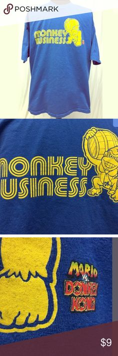 "Mario Vs Donkey Kong Tee Men's size XL Nintendo Mario versus Donkey Kong blue with yellow graphic t-shirt; measures approx 23"" pit to pit, 29"" long; gently used condition, no flaws Nintendo Shirts Tees - Short Sleeve"