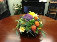 Sometimes you want something just a little different. This arrangement features all organic veggies so you can eat this arrangement too!  The colors are wonderful and the touch of rose elevates this look. Let me know if you want to see more of these!  Dave.