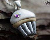 Silver Rosebud Pendant Necklace Handmade from Polymer Clay. $9.99, via Etsy.