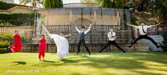 A Fun image of a bridal party jumping in front of the Caversham House ware fall.