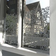 Glass is mirrored, and spray-painted through a stencil (photo Charles Desmarais)