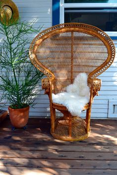 Iconic Blonde Woven Wicker Peacock Chair. Beautiful golden blonde fan style high-back wicker chair adorned with traditional cresting on top