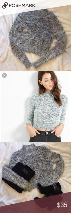 Fuzzy Marled Cropped Sweater Cropped fuzzy sweater from express. Long sleeve. Fuzzy and warm. Does not itch compared to other sweaters I have that has some wool. Size small. Excellent condition.   Super cute with black jeans and booties/boots. Always perfect to wear with your denim jeans and a black Moto jacket.   Side note: If you're not a fan of cropped sweaters, then I would wear a black undershirt. I wore it that way and it was super cute! As always, Reasonable offers are accepted…