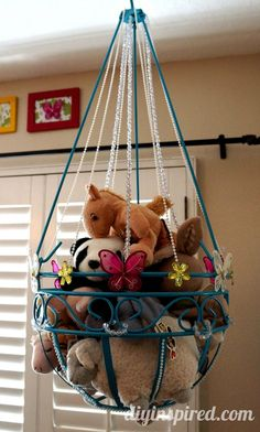 Stuffed Animal Toy Storage made from a plant hanger. I know someone who would do this for her kid
