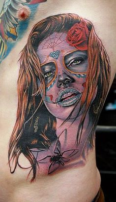 I like her expression and kick the spider out and darken the hair and add some Indian to it.... Yea, I can't wait for my day of the dead tat.