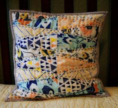 Patchwork and quilted cushion cover.