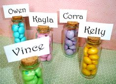 Set of 12 small glass bottles with cork. Can be used for place card holders, cake pop display, party favors, candy buffet, etc.