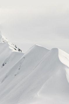 snow + mountain peaks