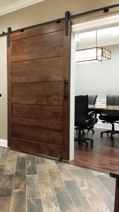 New   barn door for our conference room, and new tile for our entry.  Love the low maintenance on this 6 x 24 tile