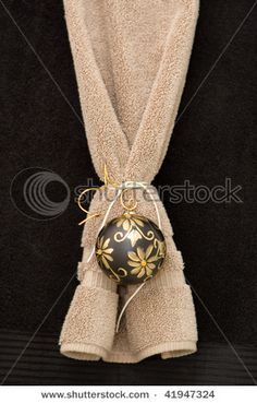 Bathroom towel decorated for Christmas with a bulb. by Steven Frame, via Shutterstock