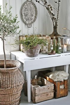 painted table, glass bottles, crates, basket, silver