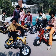 Michael Jackson and brothers Jackie, Marlon, Tito and Jermaine straddle their motorbikes by the pool, 1970.