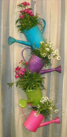 I love this with the beautiful spring colors and it can be hung from the ceiling out of the way.......BEAUTIFUL