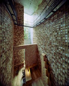Stunning museum library. Every inch of wall is filled with books. The Library at the Shiba Ryotaro Memorial Museum, designed by Tadao Ando, Osaka, Japan