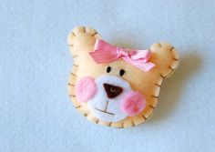 Felt brooch teddy bear, pink. Pin on the new mommy at your teddy bear themed baby shower!  Add some Patchi Bedtime Teddy Chocolate favors to the celebration for a special treat. http://patchi.us/baby-girl-teddycutout-favor.html
