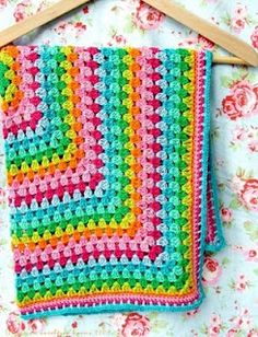 love the bright cheery colours in this baby blanket