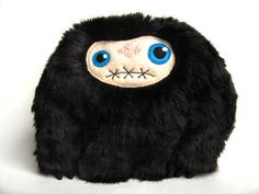 Meet Silent Bob. He's a new stuffed monster with a new face style in the Curious Little Bird shop. He's a silent monster. His mouth is sewn shut, so he can't talk. He has embroidery french knot details on his forehead which make him a one of a kind plush toy.Silent Bob measures 10 inches tall, and 10 inches wide. He's made out of super soft black fur, and black felt horns. His face is embroidered, and the french knots were hand done.Silent Bob is a one of a kind monster. $60